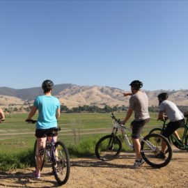 Riders on a group tour admiring the view at the Old Tallangatta Lookout