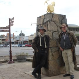 Dan and Ian standing leaning against granite cann