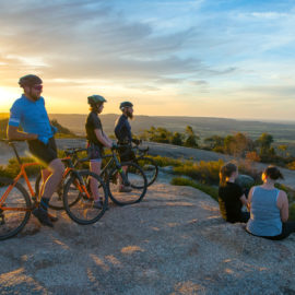 Cyclists enjoying the sunset view on top of Mt Pilot, Chiltern